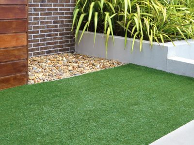 Combination of timber, plants, rocks, artificial grass, brick and render wall