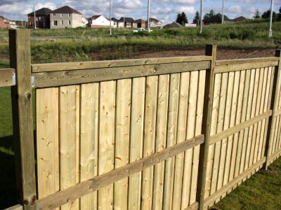A shot of a new fence under construction, in a new subdivision.